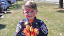 Oliver the Kid Cop Hands Out Flowers at Nursing Homes