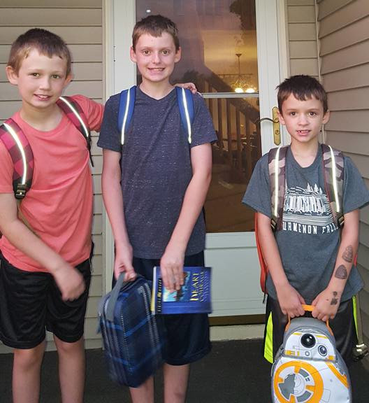 Three boys going back to school