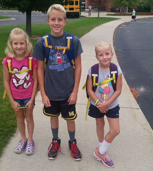 Two brothers and a sister going back to school