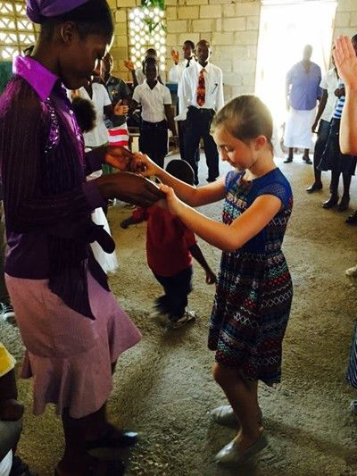 Dancing in Haiti with her new friends :)